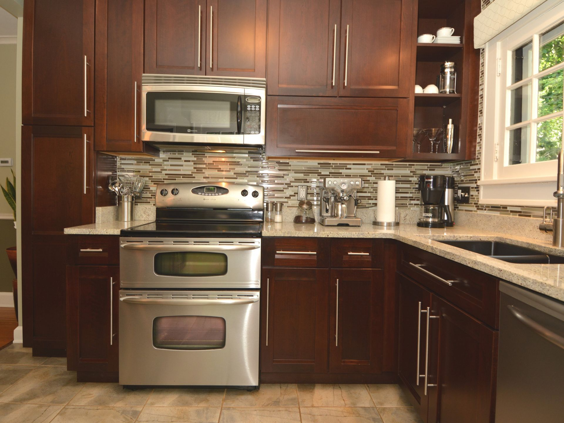 The kitchen has been pleted remodeled with cherry cabinets