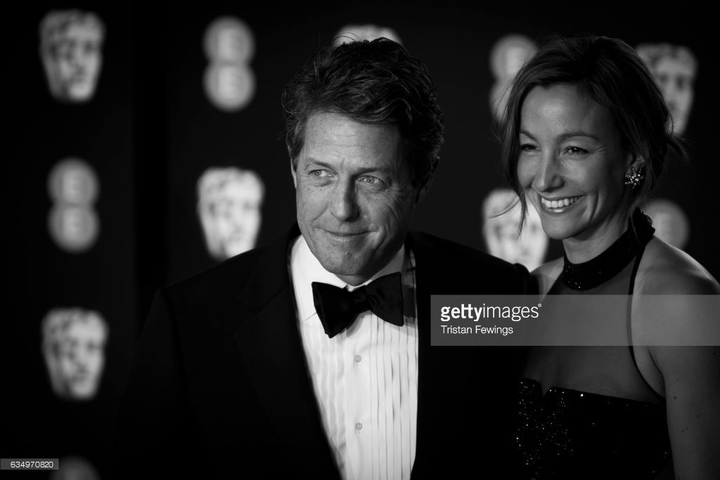 Hugh Grant and Anna Elisabet Eberstein attend the 70th EE British Academy Film Awards (BAFTA) at Royal Albert Hall on February 12, 2017 in London, England.
