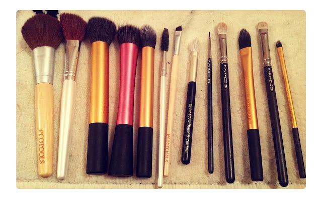 L-R: Eco Tools powder brush, E.L.F. angled blush brush, Real Techniques buffing brush, stippling brush, contour brush, E.L.F. lash/brow brush. Eco Tools angled eyeliner brush, No. 7 eyeshadow shading and blending, MAC 210, 217, Real Techniques foundation brush, MAC 239, Real Techniques concealer brush