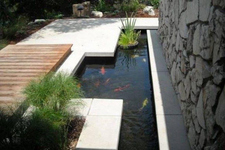 Minimalist Garden House With Fish Pond