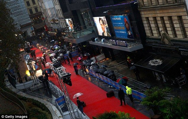 Red carpet: Crowds gathered in the rain outside London's Leicester Square for the official...
