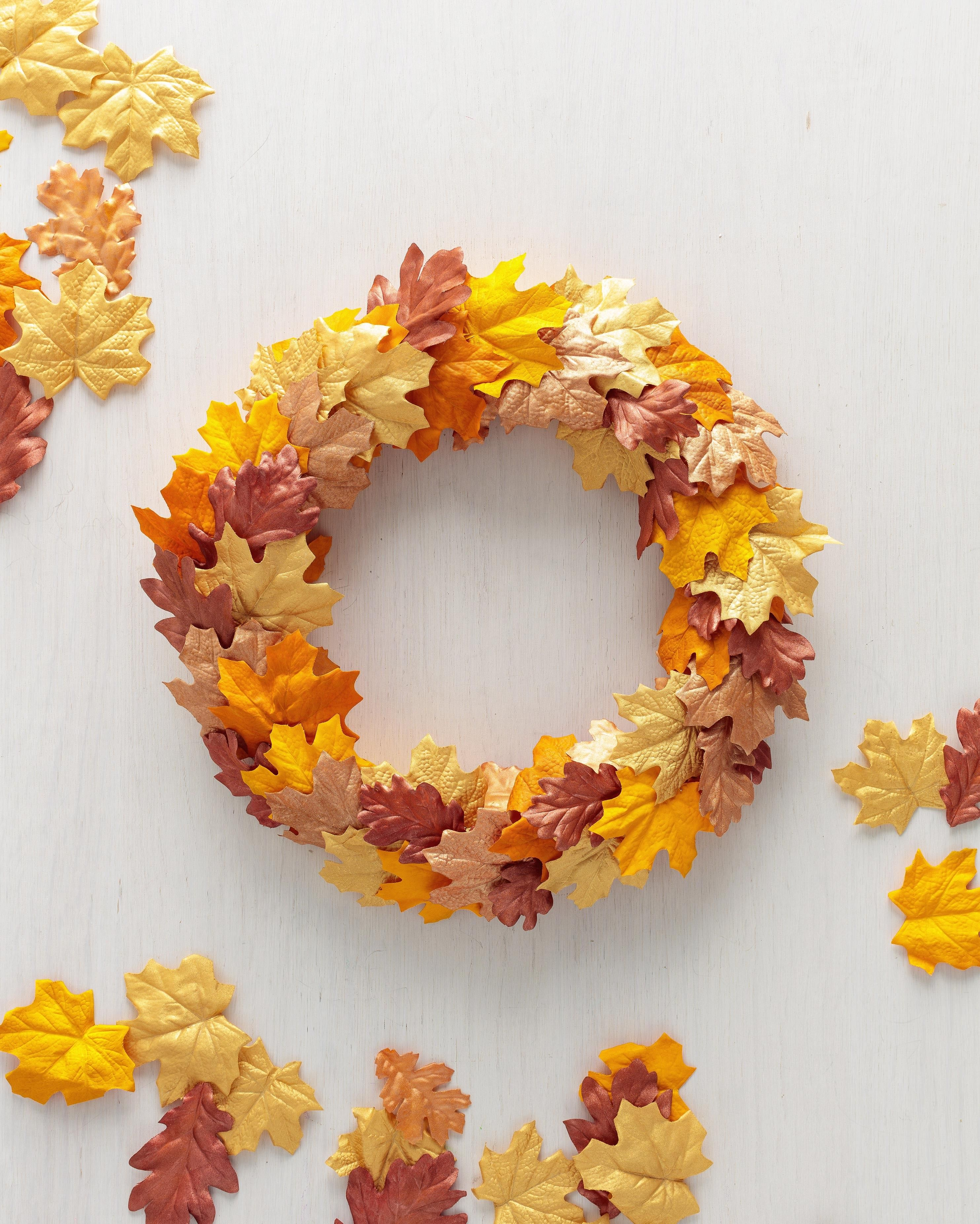 12 Leaf Crafts That Celebrate All The Colors Of Fall Wreaths Diy Wreath Autumn Leaves Craft