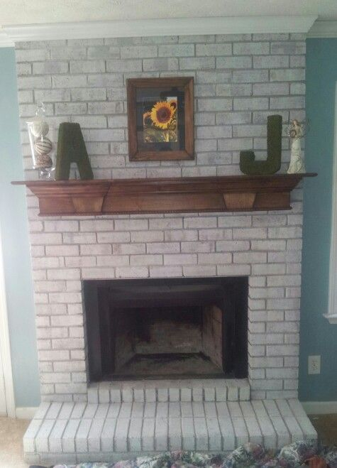 White Washed Brick And Bombay Mahogany Stained Mantle White Wash Brick Fireplace White Wash Brick Family Living Rooms
