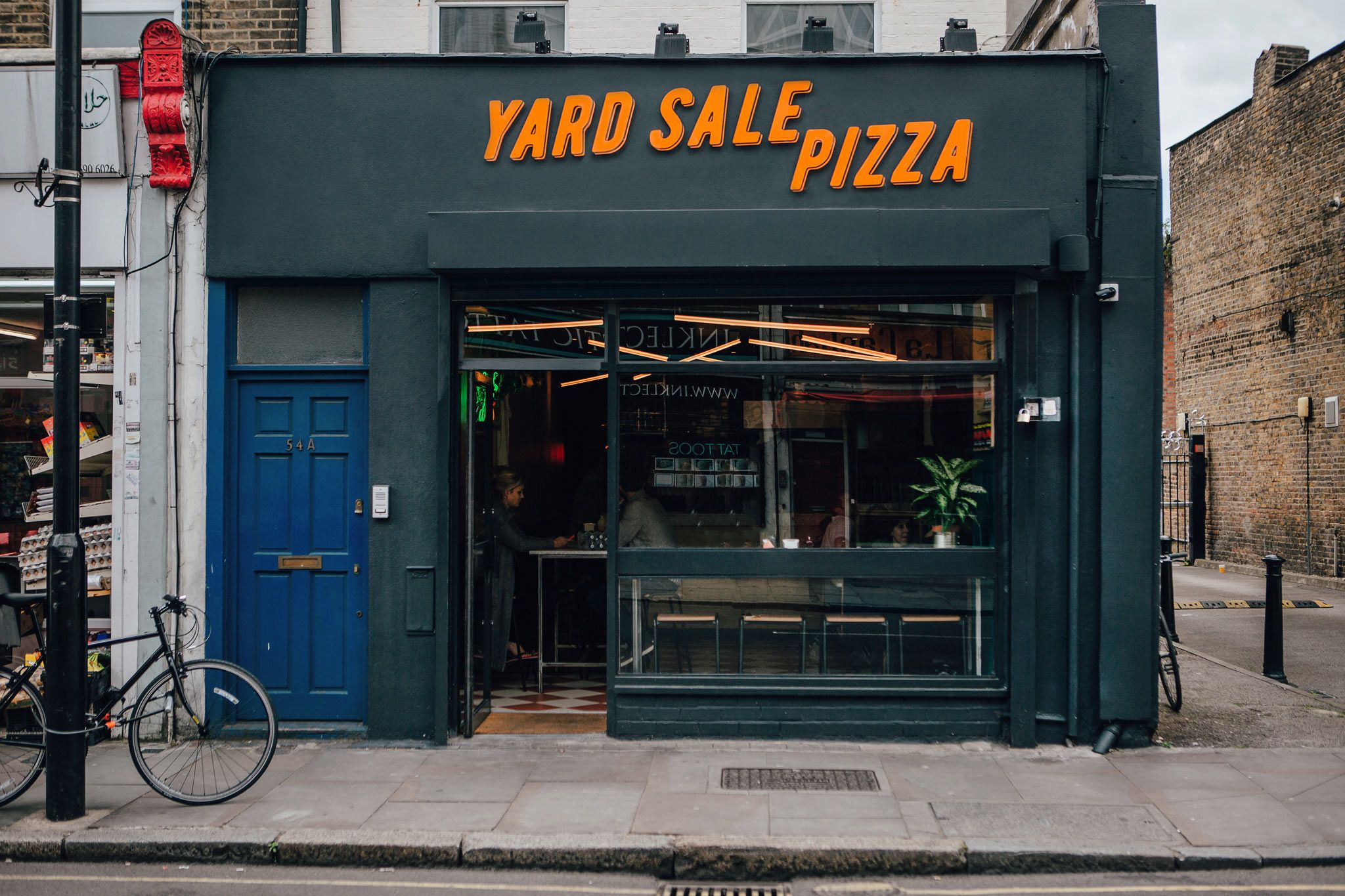 Yard Sale Pizza / Brand Identity.   Shop front and signage design for the Finsbury Park shop.  Hand drawn logo produced in Orange acrylic.