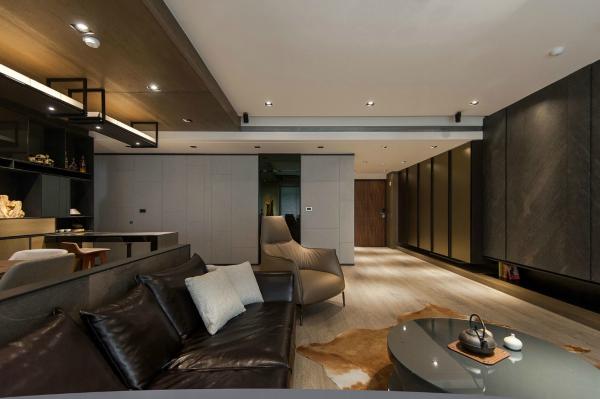 Stone and wood make a dark masculine interior