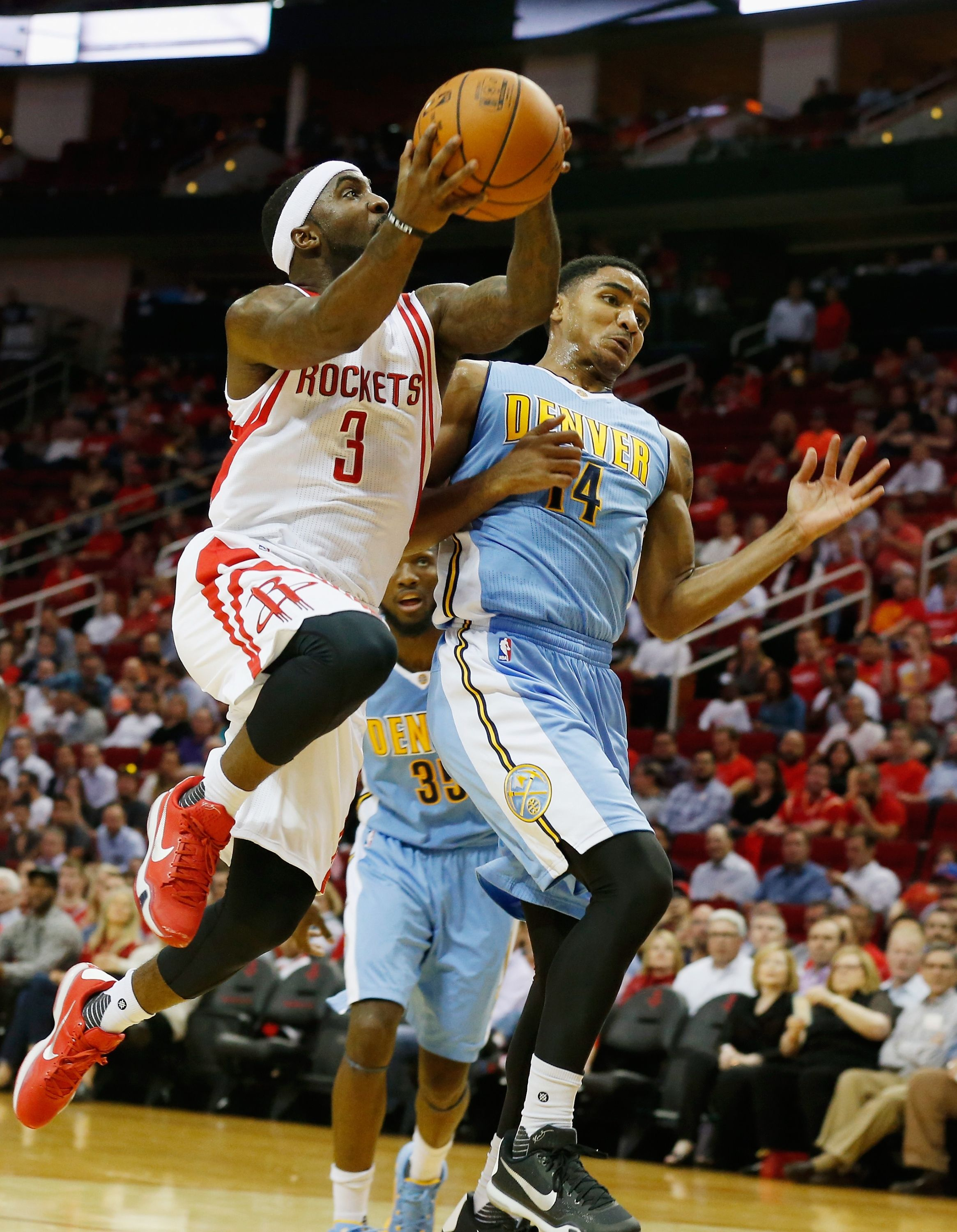 Ty Lawson #3 of the Houston Rockets drives with the basketball against Gary Harris #14 of the Denver Nuggets during their game at the Toyota Center on October 28, 2015 in Houston, Texas.