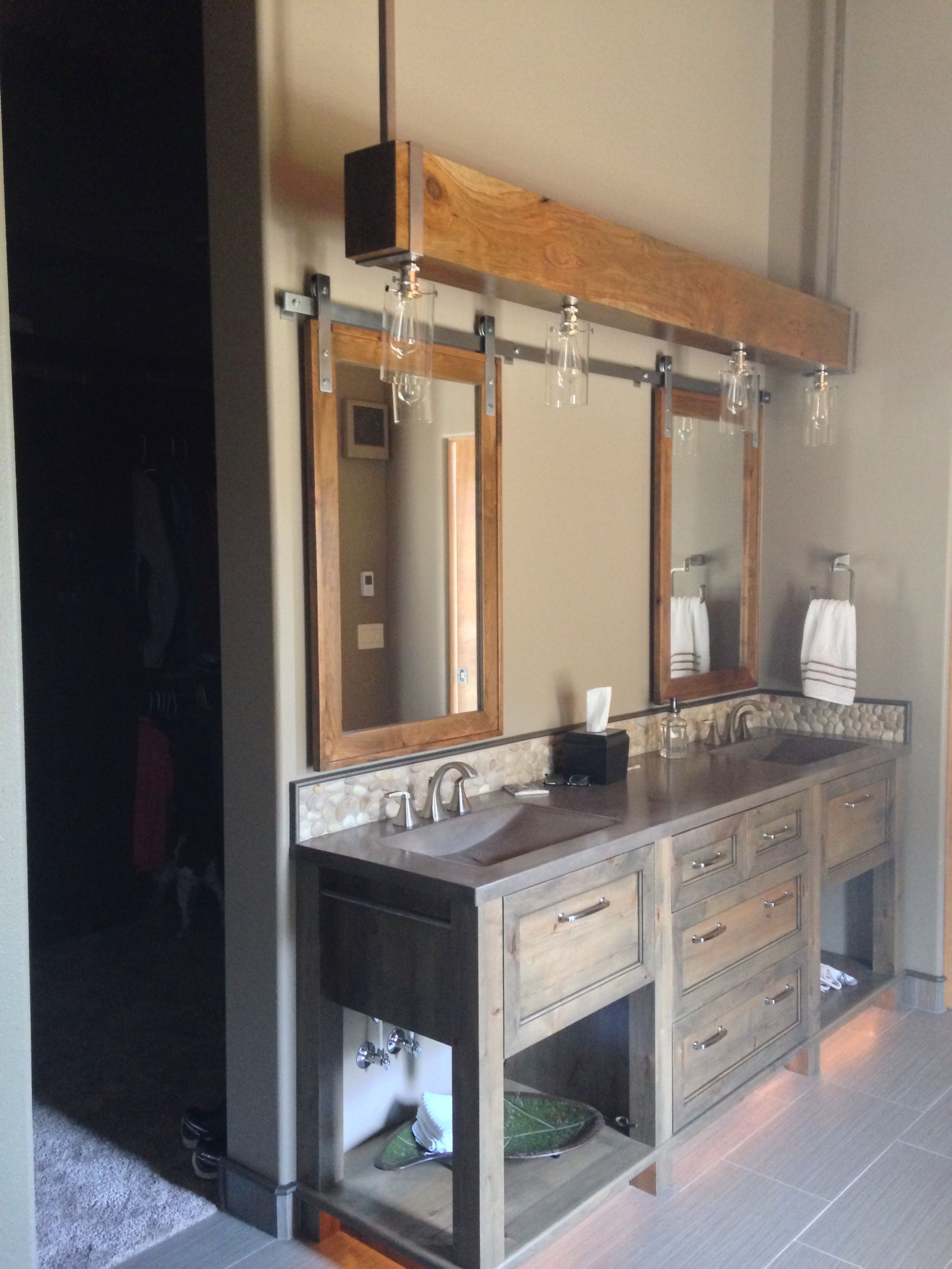 Suspended beam with lighting. Barn door medicine cabinets ...