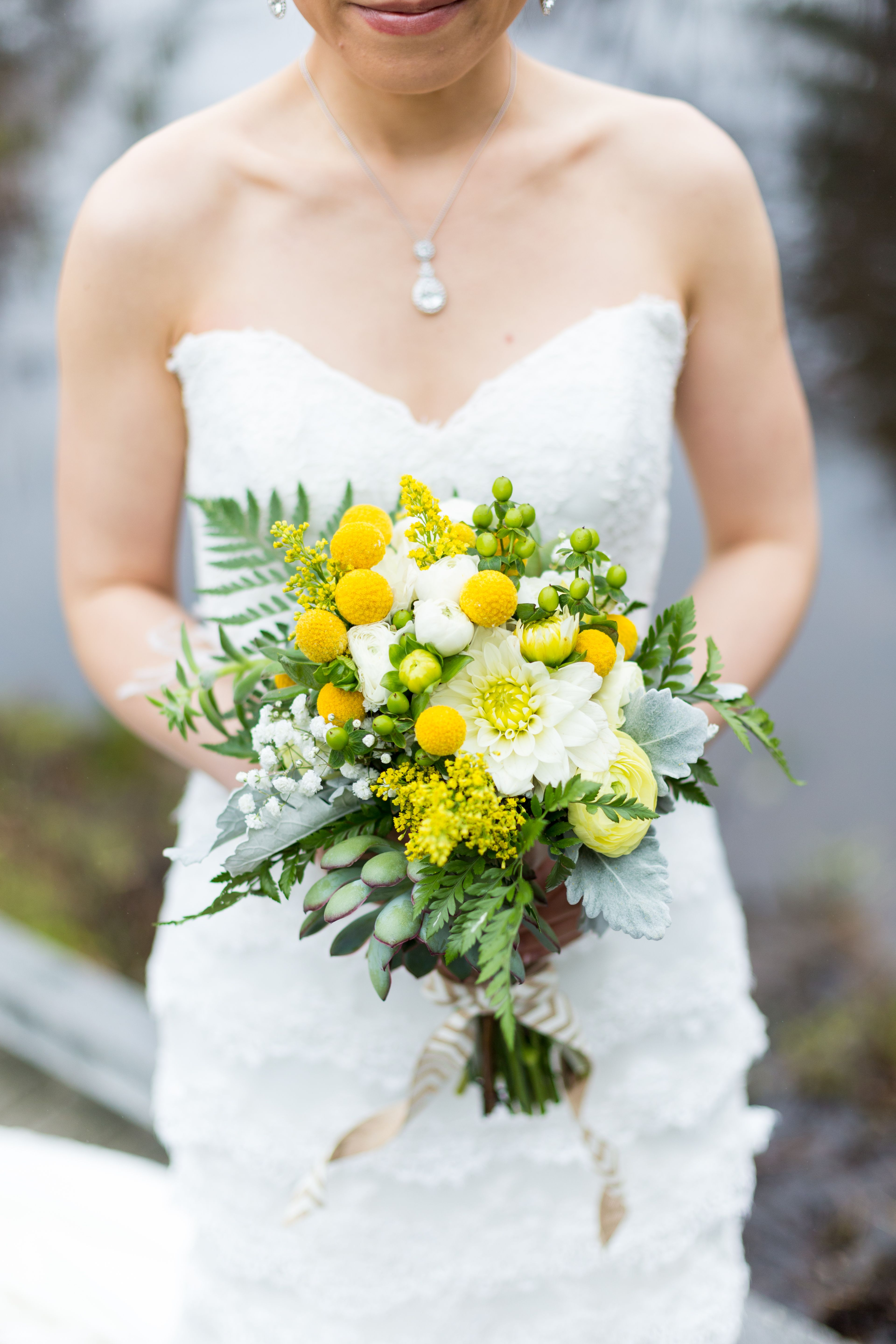 Bride with beautiful spring floral bouquet - green white ...