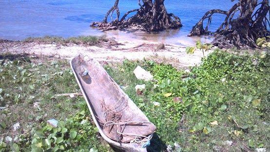 homemade canoe in Honduras