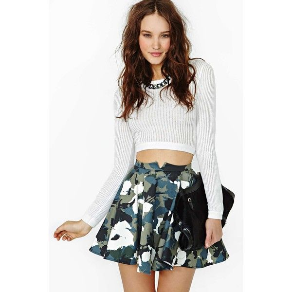 Nasty Gal Hidden Bloom Skater Skirt (£39) ❤ liked on Polyvore featuring skirts, outfits, models, front slit skirt, cotton skater skirt, flared skirt, camo skirt and floral print skirt