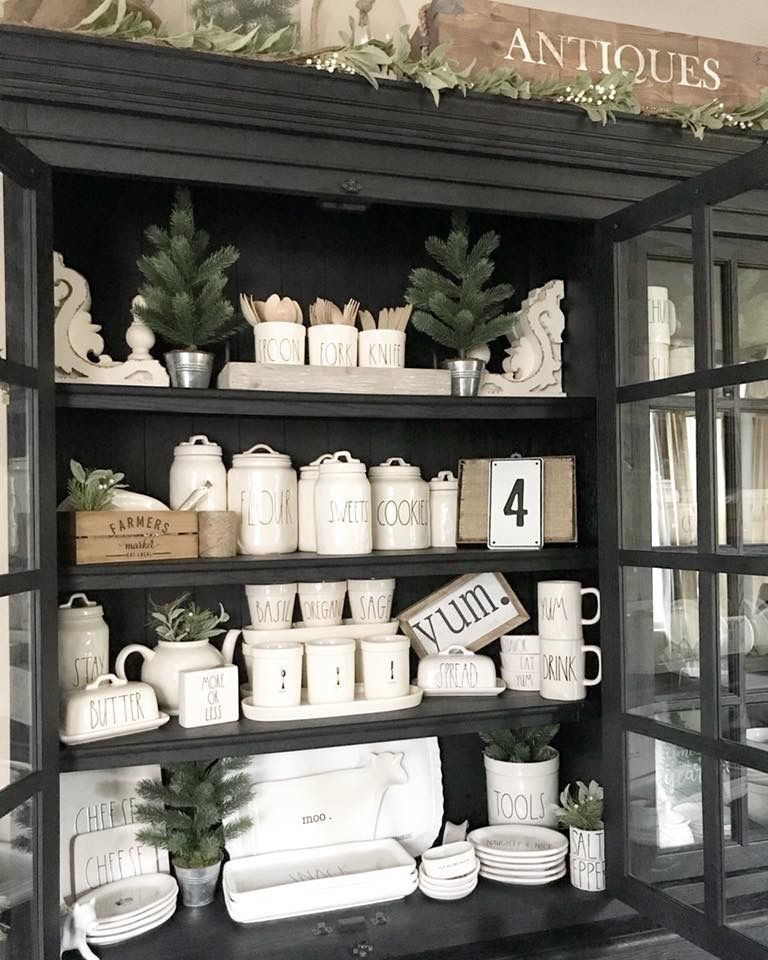 love the white pieces in this black hutch. | farmhouse style | black