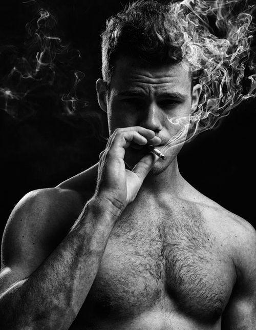 Gay Man Smoking A Cigarette On Tropical Beach Stock Photo