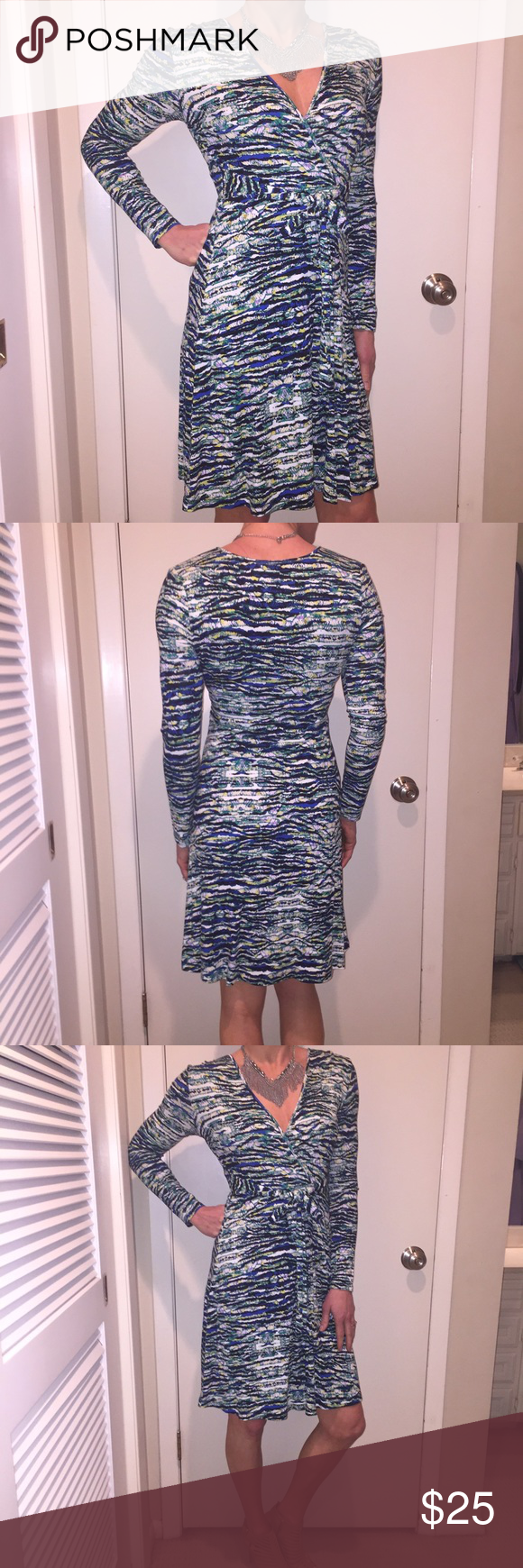 ❄️Striped wrap dress Striped wrap dress with tie waist. Blue, green, black and yellow colors.  Stretchy soft material, super comfy! Worn once, like new! Cynthia Rowley Dresses