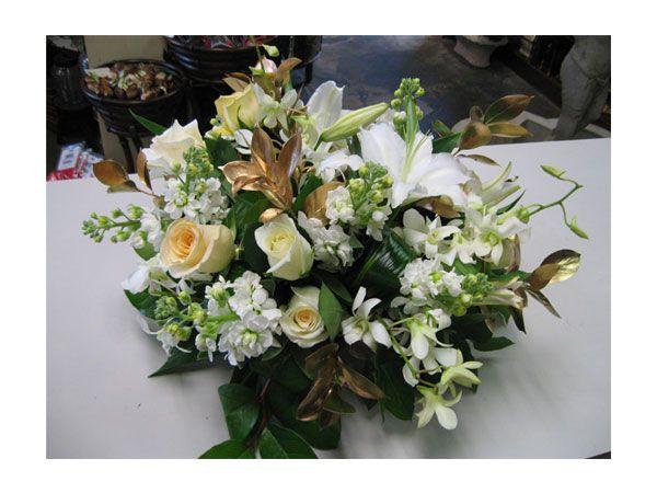 arreglo de flores dorado centro de mesa para boda