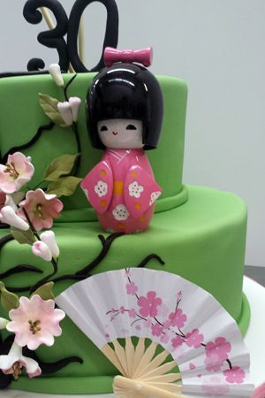 A Jade Japanese Birthday Cake for a 30th birthday celebration decorated with a miniature paper fan.