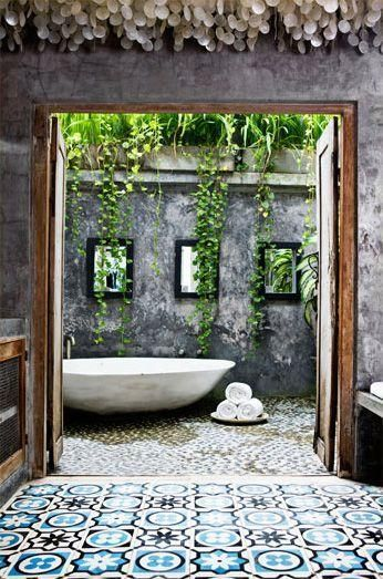 Concrete and timber, a dramatic pop of pattern, pebbles and plants cascading…