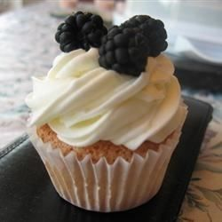 This is a YUMMY whipped cream frosting that is very stable and does not melt at room temperature unlike many standard whipped cream frostings.  It also makes a GREAT dip for fresh fruit -- not too sweet, just right! This recipe is GREAT for a stand mixer but will work with any good mixer.