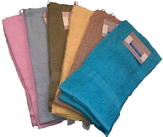 "Solid Terry Hand Towel Measures: 16"" x 26"" 100% terry cotton. Assorted colors 10 single ringspun. 2.5 oz."