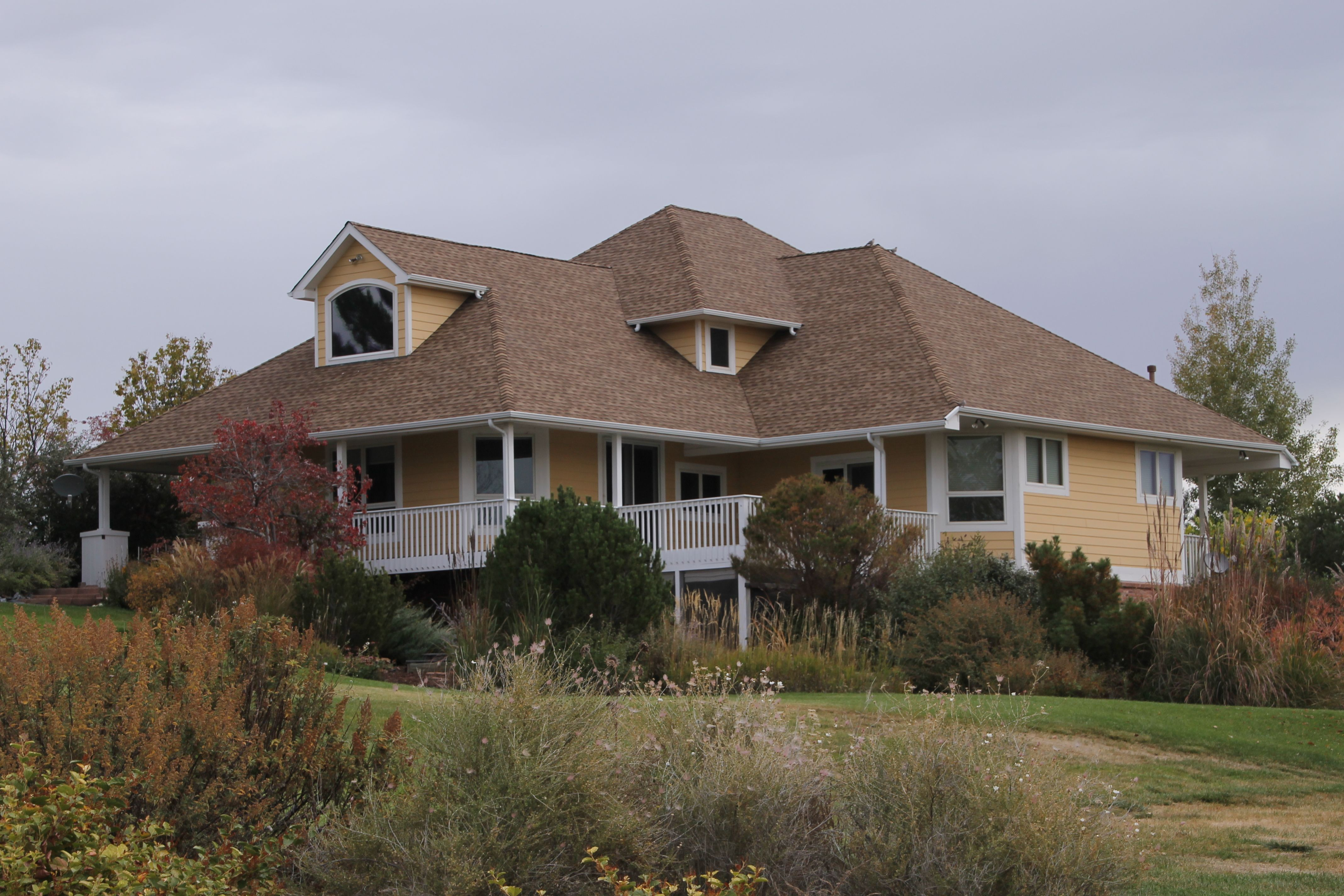 This Home In Berthoud Has Snakewood Shingles Installed From The Gaf Timberline Hd Shingle Line Architectural Shingles Roof Shingle Colors Roof Shingle Colors