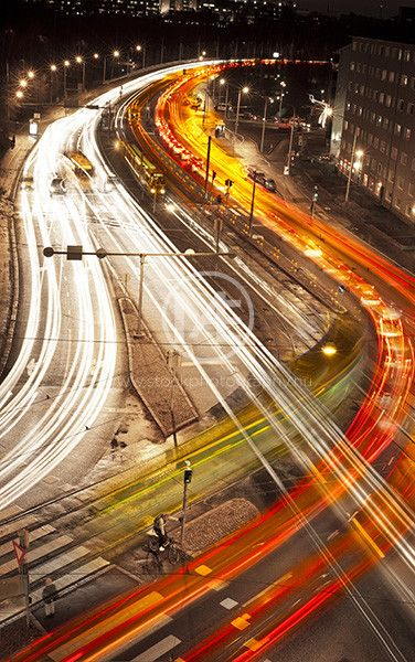Light Trails Of Cars Passing On A Busy Crossing In Helsinki