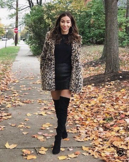 5ff0da03cff Faux Fur statement coat in leopard print. Over the knee black suede boots.  Leather skirt. Fall fashion.
