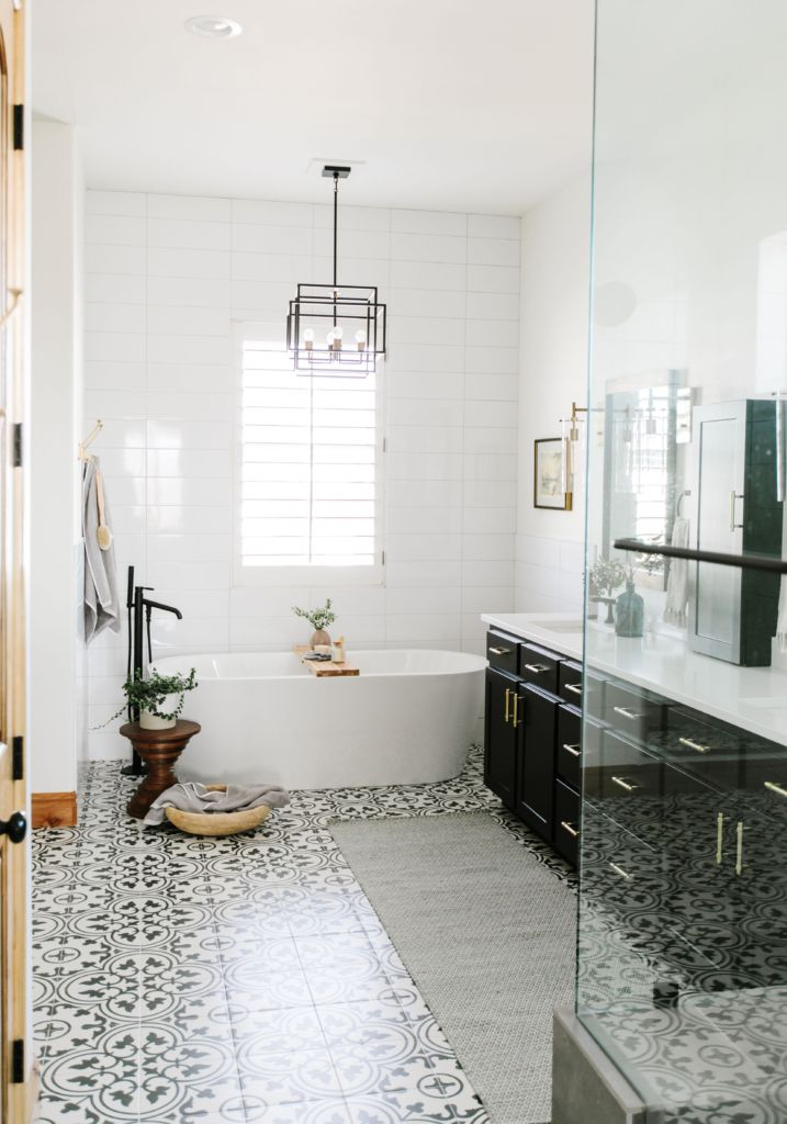 Photo of Bathtub in the new black and white bathroom
