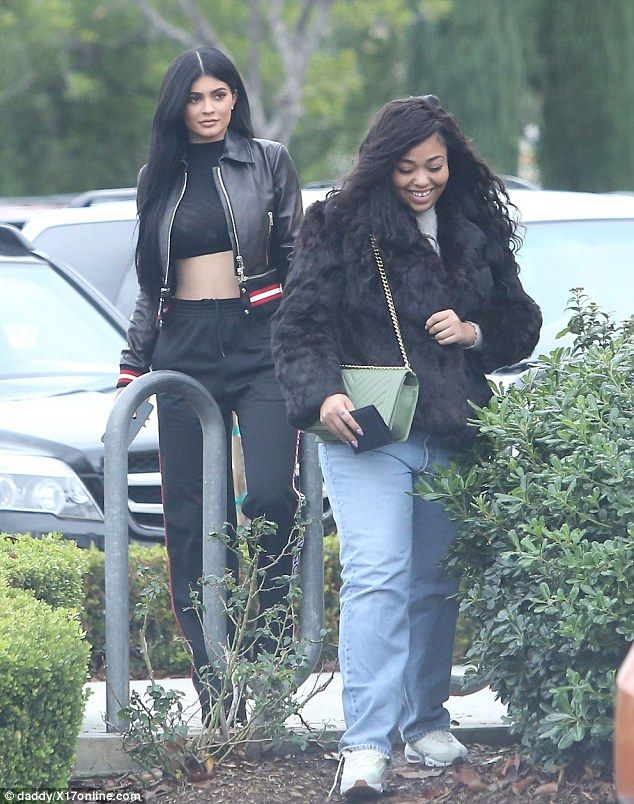 Home sweet home: Kylie Jenner returned to her native Calabasas Thursday along with her best friend Jordyn Woods (R) following their lavish Mexican getaway