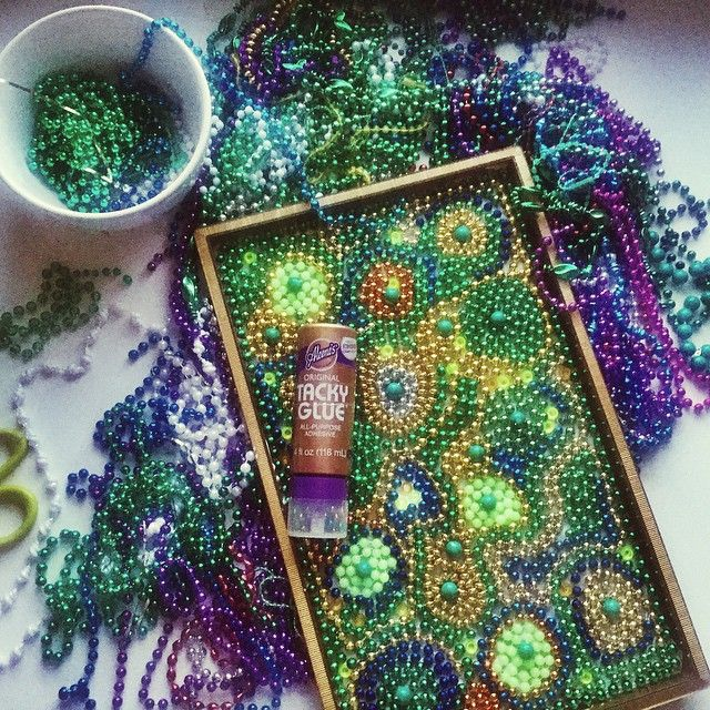 This is my third tray made from mardi gras beads and #tackyglue. Like I needed another reason to collect sparkly things.