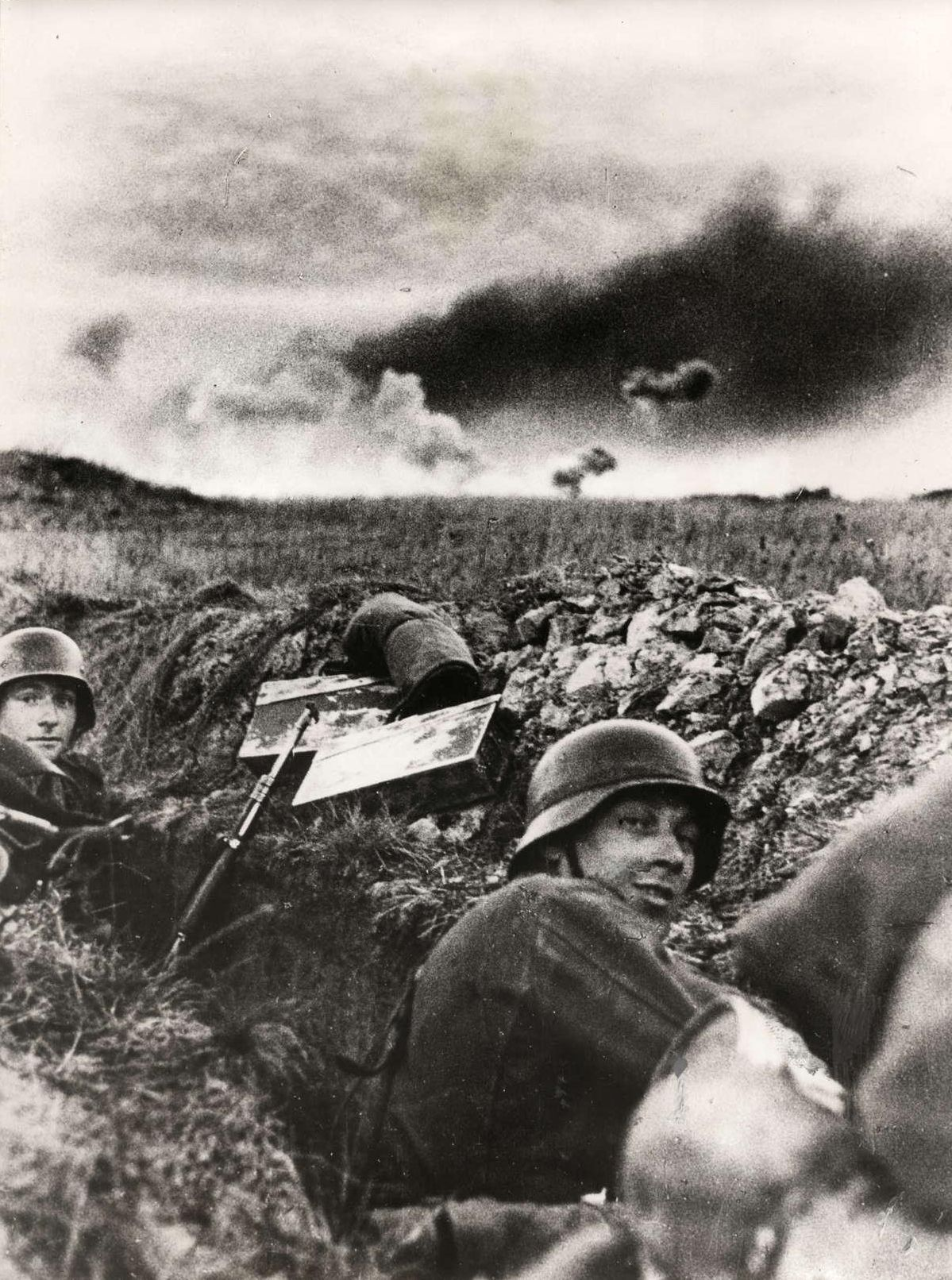 German Soldiers Taking Cover In A Ditch While Artillery Explodes On The Horizon Eastern Front 1941