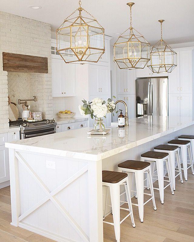White Country Farmhouse Coastal Kitchen With Brass Light Fixtures
