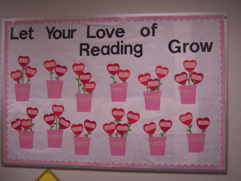 This is a cute idea for a Valentine's Day bulletin board with a reading theme. Have each student design a heart flower describing a book that they love and place the flowers in flower pots or a create a garden for your bulletin board display. #valentinesdaybulletinboardideas