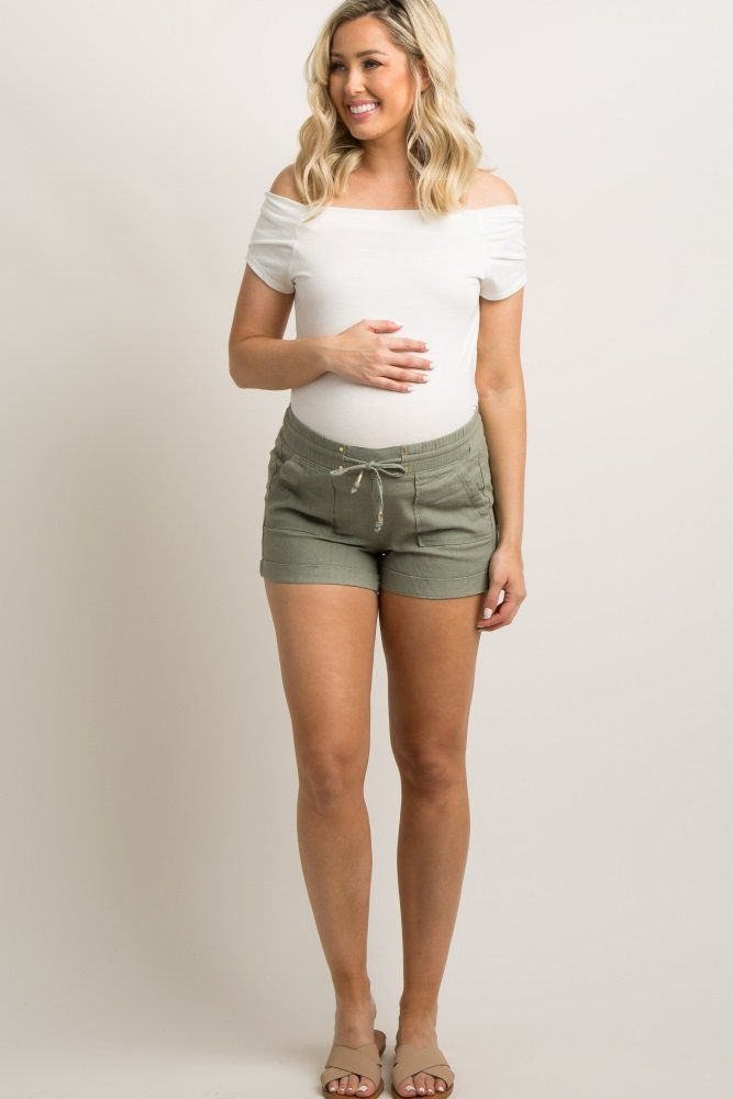 23ed99f27a473 Olive Linen Drawstring Short A pair of solid hued, linen maternity shorts  featuring a cuffed