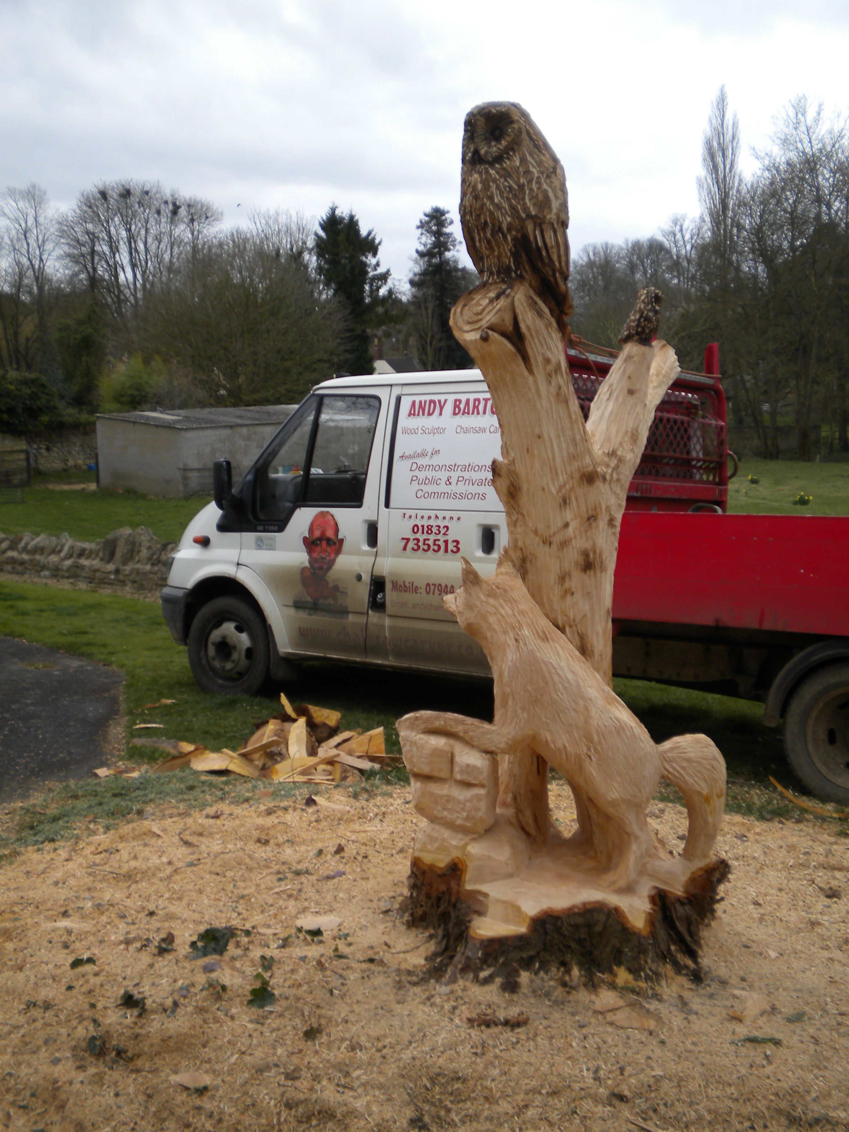 Garden tree stump chainsaw carved into owl and fox chainsawcarver