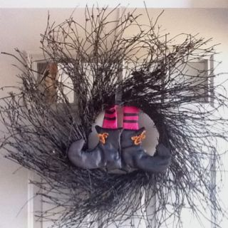 Spray painted the wreath black and added the witch feet to it! Perfect Halloween wreath!!!
