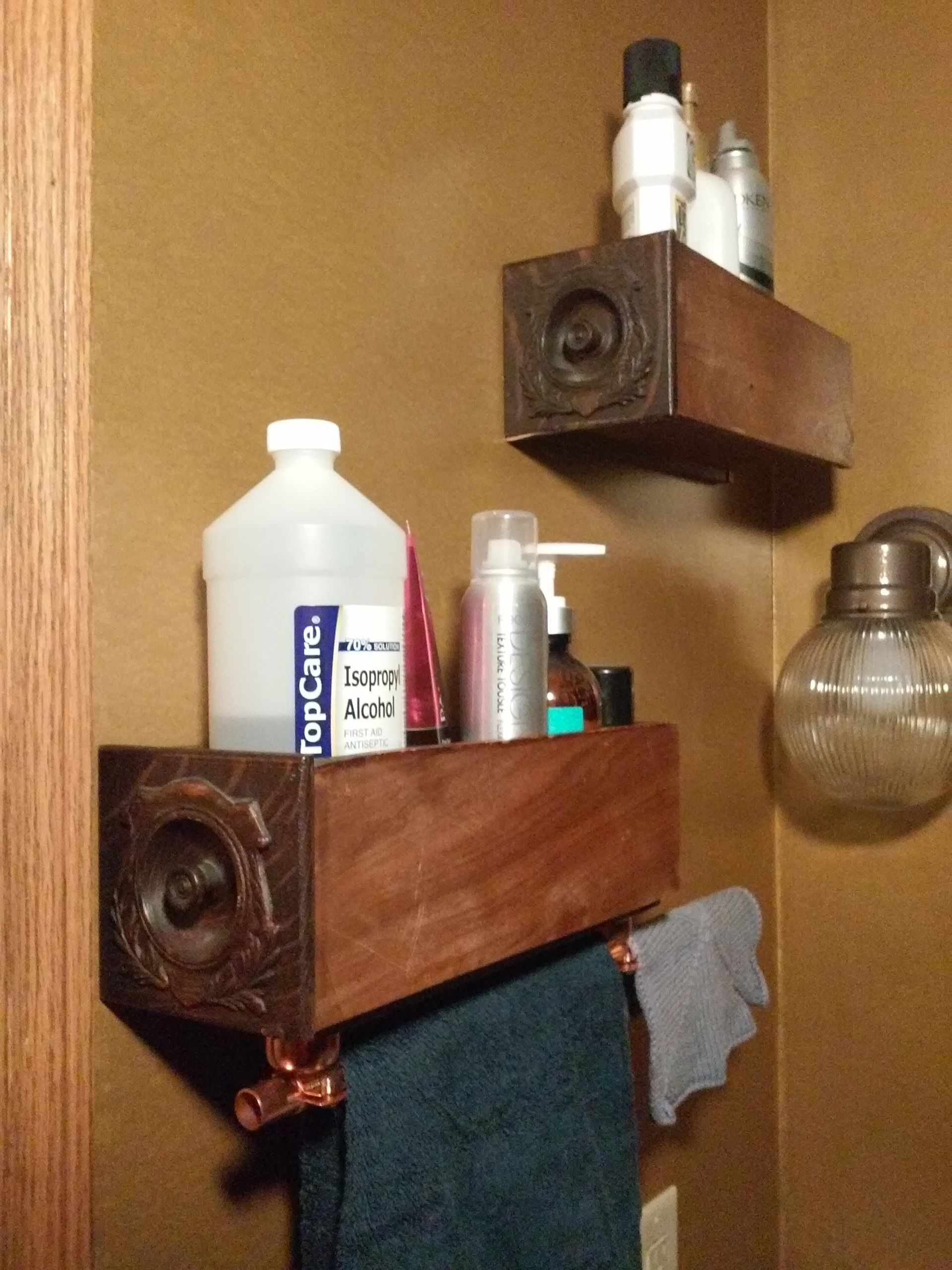 Old Sewing Machine Cabinet Drawers Used As Shelves, With Copper Pipe Under  One To Act As Towel Holder