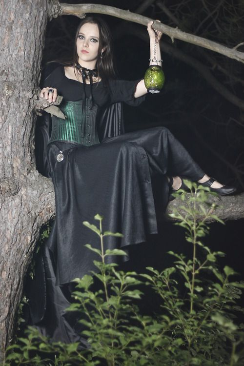 """Pecze Margit submitted this photo with the comment """"Hi, I'm Margit from Hungary, and this is me on a pine tree. It was taken after a photoshoot at 2am, maybe it explains my slightly psychopathic expression. And no I'm no lost daughter of Green Lantern. :)"""""""