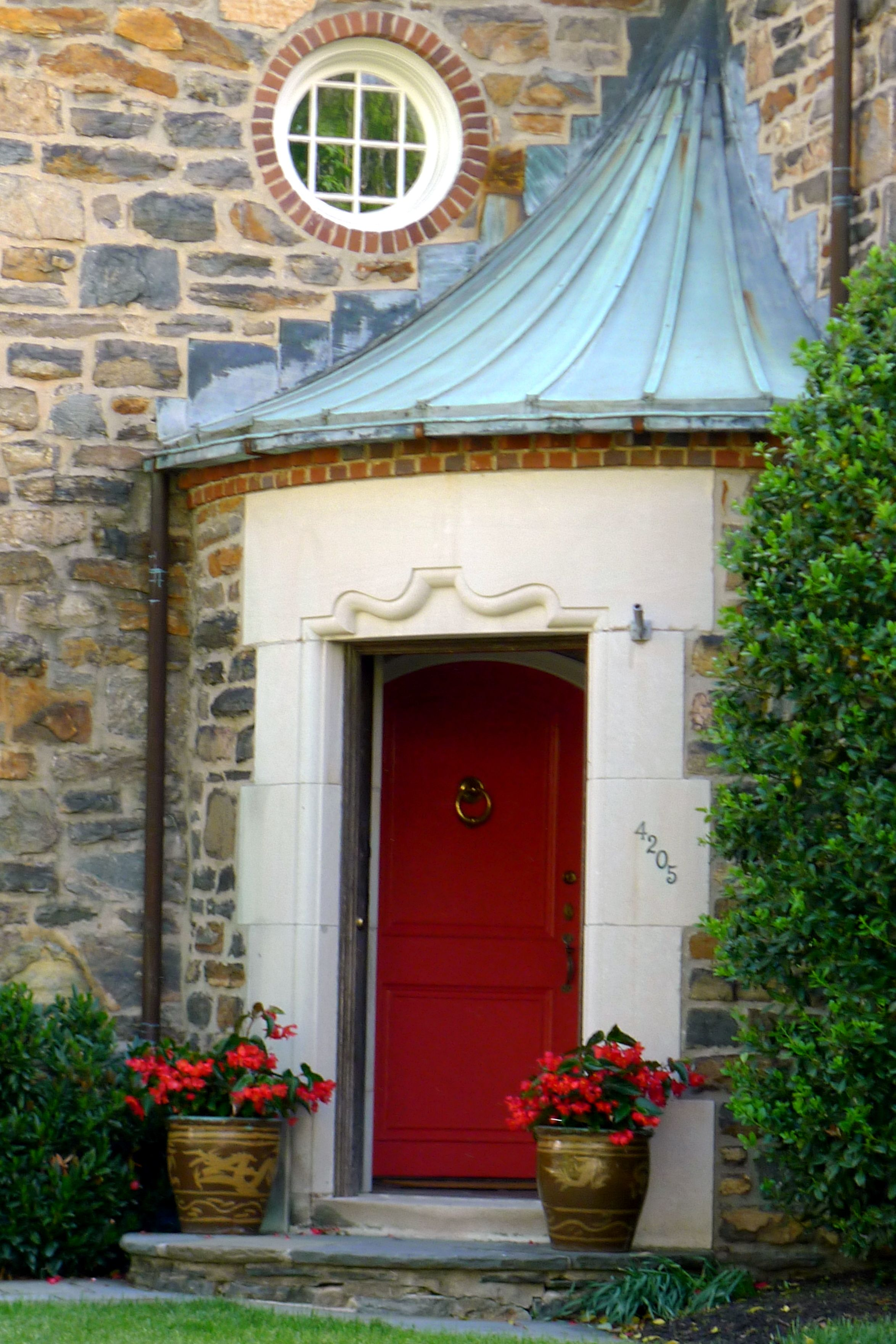 Baltimore, MD 1920s Field Stone Home With Red Entry Door, Half Circle  Portico, Copper Roof And Round Window