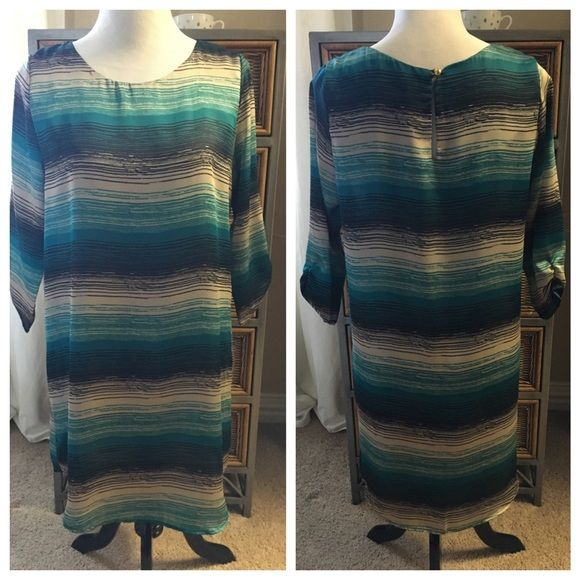 NWOT-Summer Striped Dress NWOT. Boutique find. Ocean colors, thin silky-like feel. You may want to wear nude biker shorts underneath. 3/4 sleeves with elastic. Beautiful colors for spring or summer. Not fitted, has a loose shift style fit. Dresses Midi