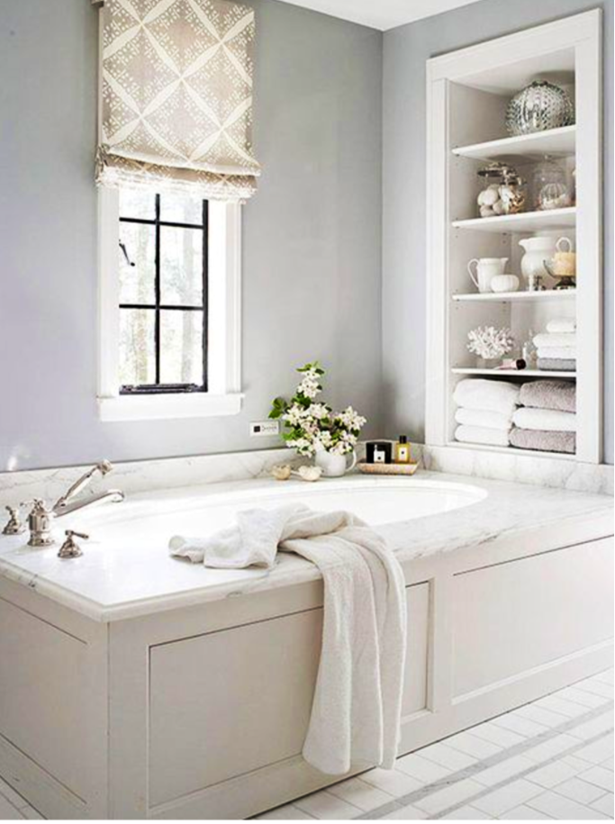 Simple but classic soaking tub and built in cubby with for Bathroom built in shelving ideas