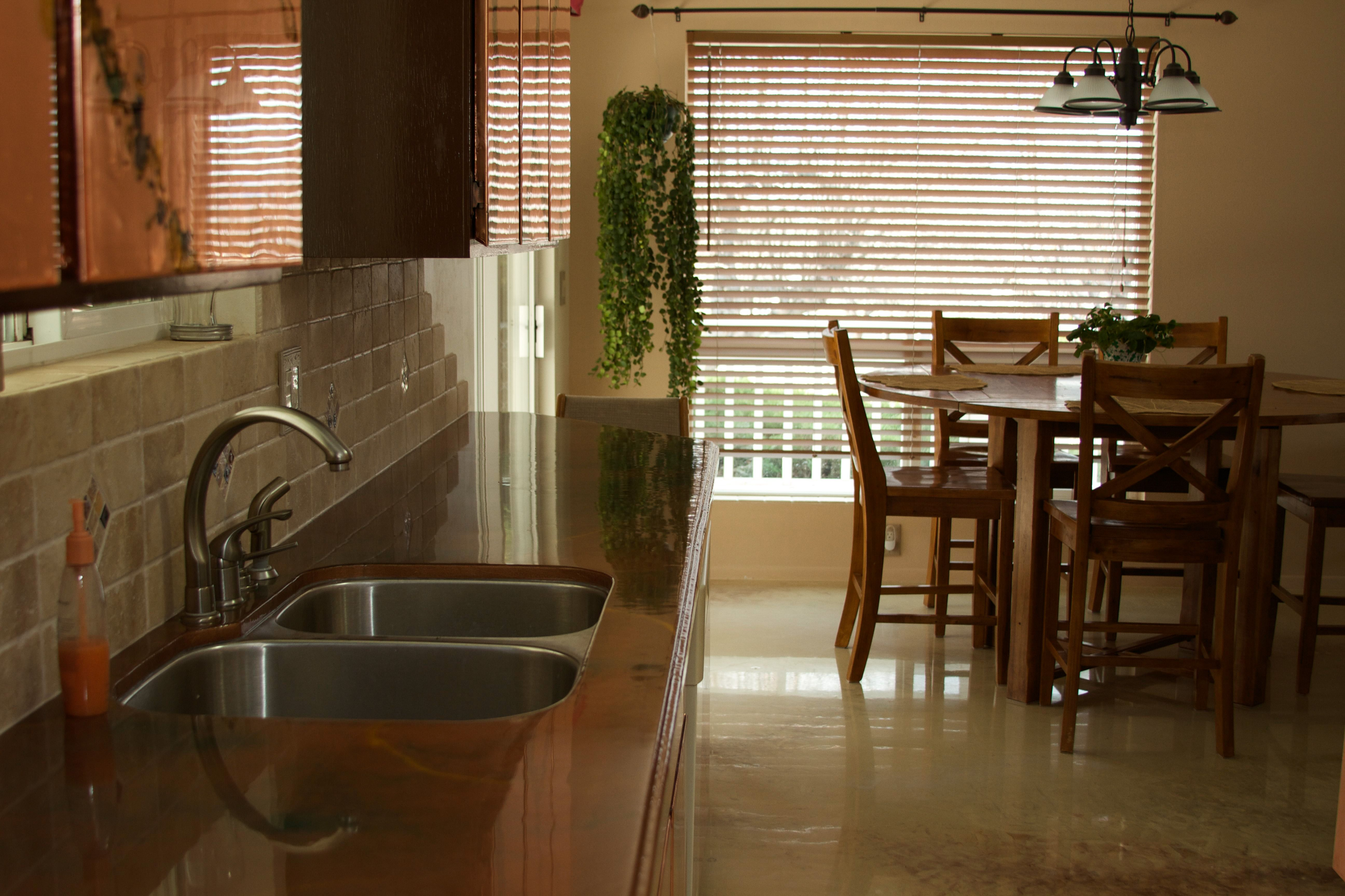 Copper cabinet doors, countertops and Travertine flooring ...
