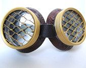 Hive Steampunk Goggles Air Pirate Eyewear Steampunk Glasses-  Brass Colored Lenscaps Burning Steampunk man. $24.99, via Etsy.