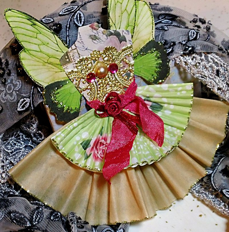 Fairy dress...made from a natural coffee filter, cupcake paper and lots of glitter.