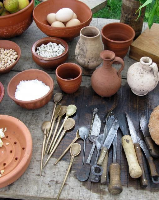 Stone, pottery, wood and metal pot and pans were cooked in, as cooking did not change much until 16th cen. In whole the medieval period owed too much to the Roman ways of life that