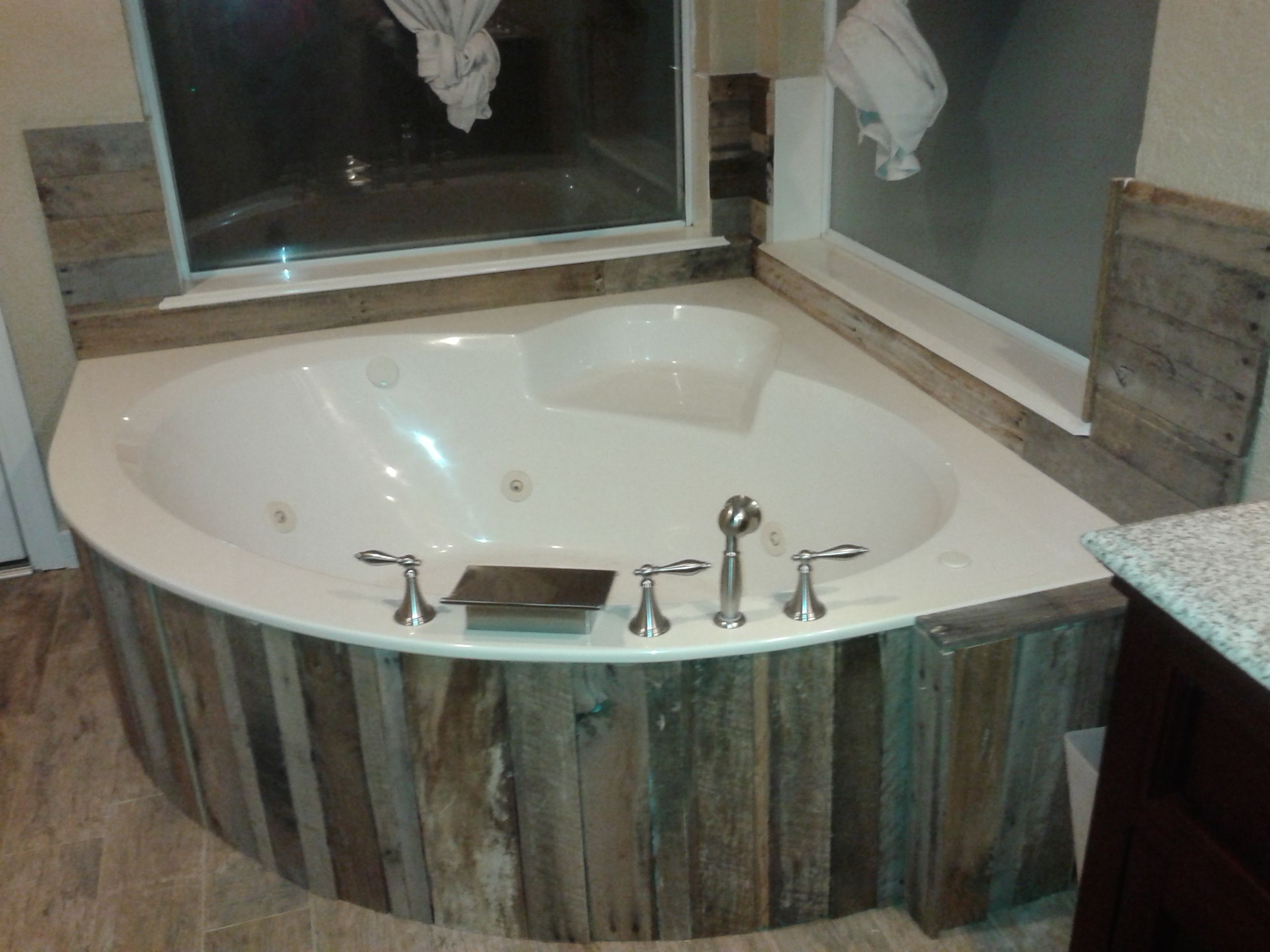 Bathroom Faucet Used used pallet wood to redo my tub surround and accent the walls