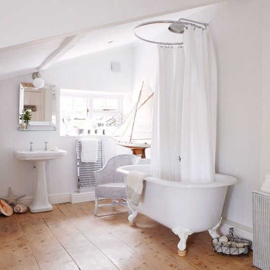 Lovely light bathroom...Love the sails on the model ship...