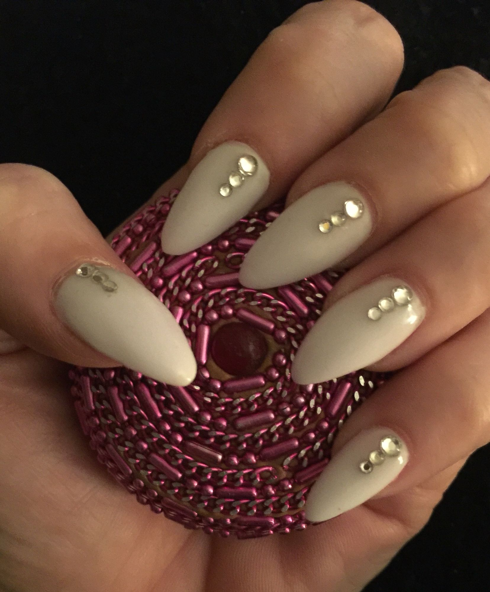 Elegant Stiletto Nail Art: White Stiletto Nails With Rhinestones.
