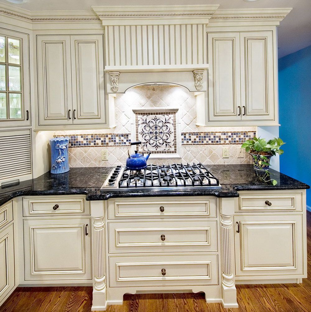 backsplash for white cabinets and black granite countertops