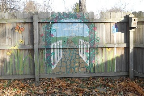 garden gate mural painted in acrylic on a wooden fence located in