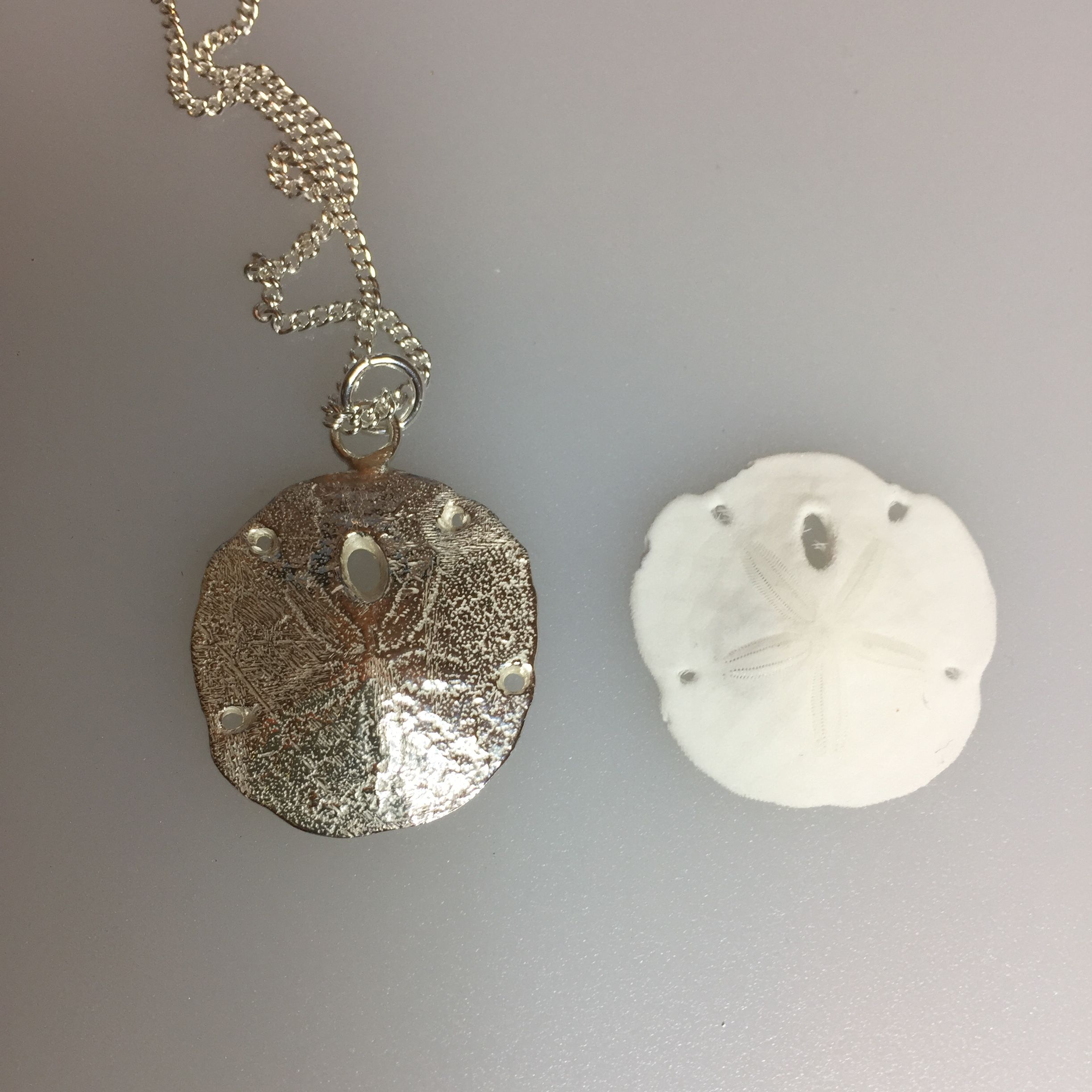 Sterling silver sand cast sand dollar pendant bling pinterest sterling silver sand cast sand dollar pendant aloadofball Image collections