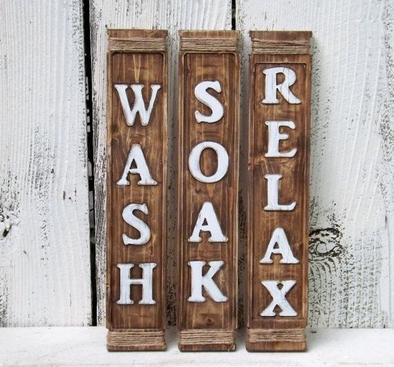 Set of 3 rustic wood signs WASH~SOAK~RELAX Wood signs have embossed lettering . Hand painted in white, slightly distressed giving that rustic look